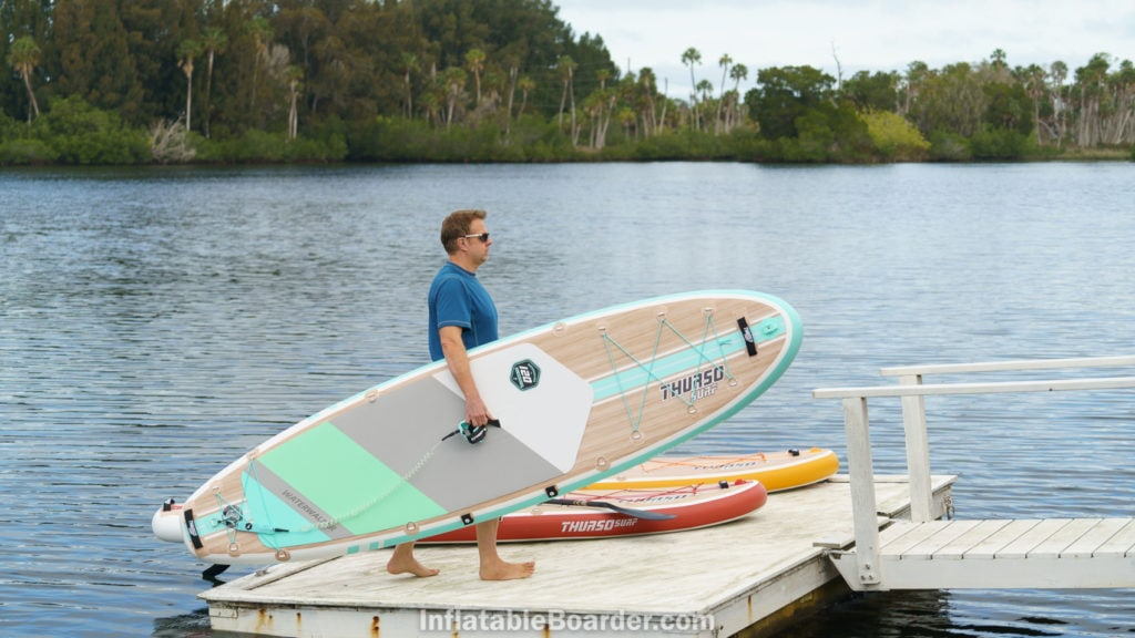 Carrying the Waterwalker 120 on a dock, with 126 and 132 in background.