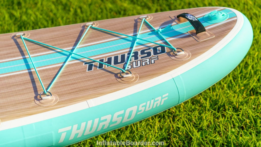 The front of the board showing the side logo, full cargo area, padded handle and action mount.