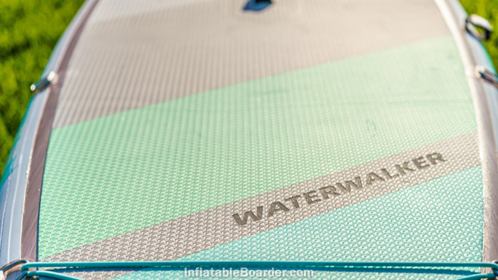 The foam deck pad is wide with a sharkskin texture for grip.