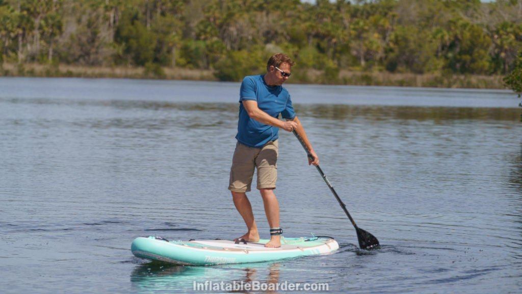 A man turning the Waterwalker 120' on a calm lake.