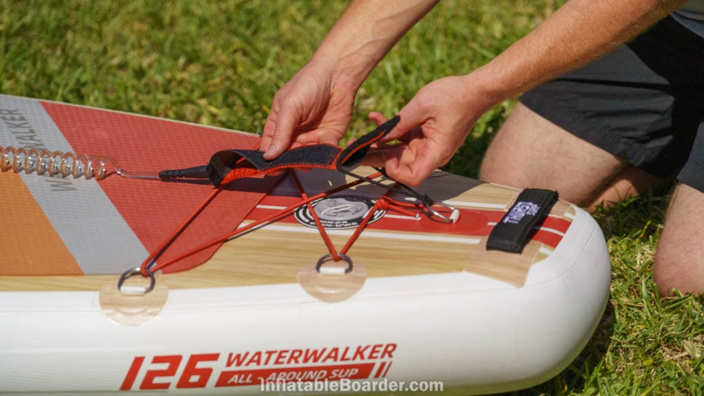 Attaching the velcro SUP leash at the back of the board.