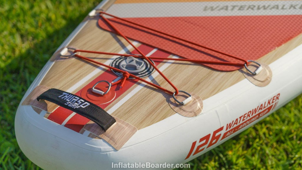Rear of the board with detail of the padded handle and leash attachment d-ring.