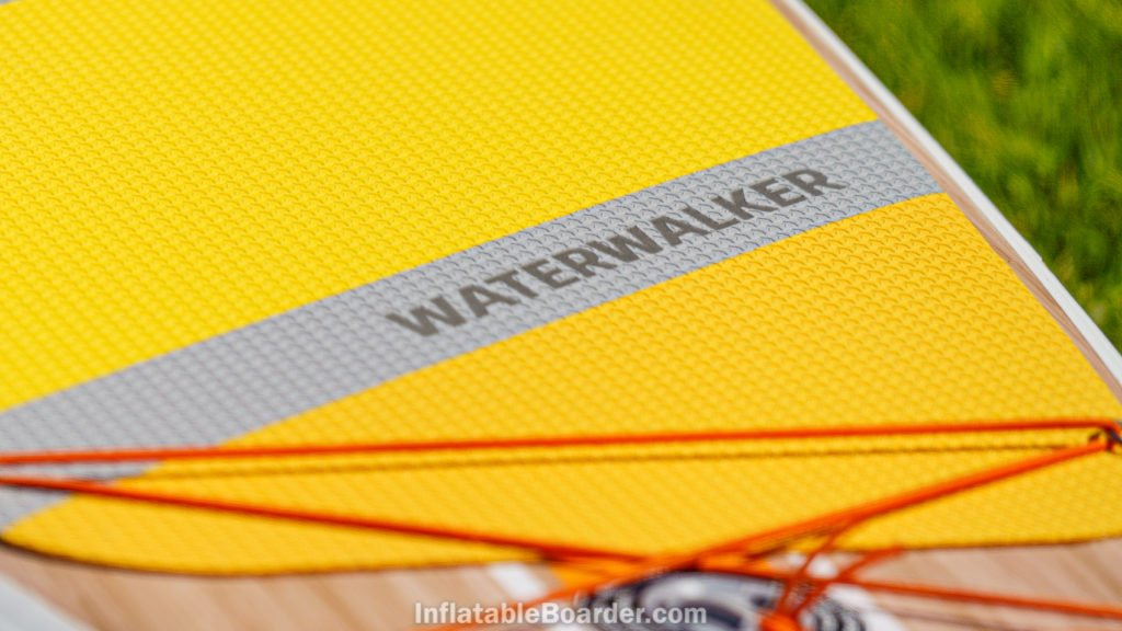 The wide deck foam has a sharkskin pattern for grip, composed of the Thurso Surf logo.