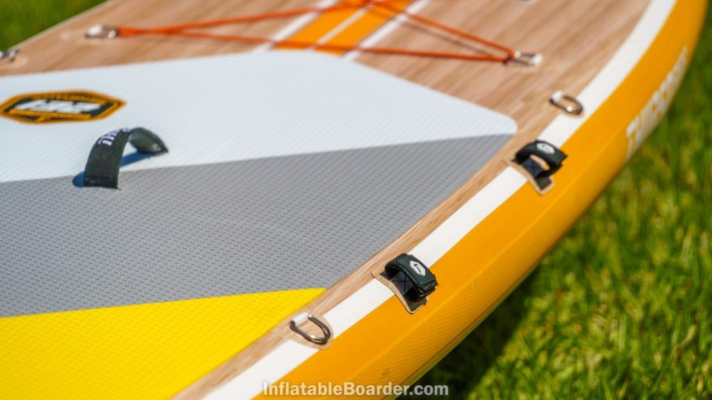 The side of the board has two velcro strips for holding the paddle, as well as two d-rings.