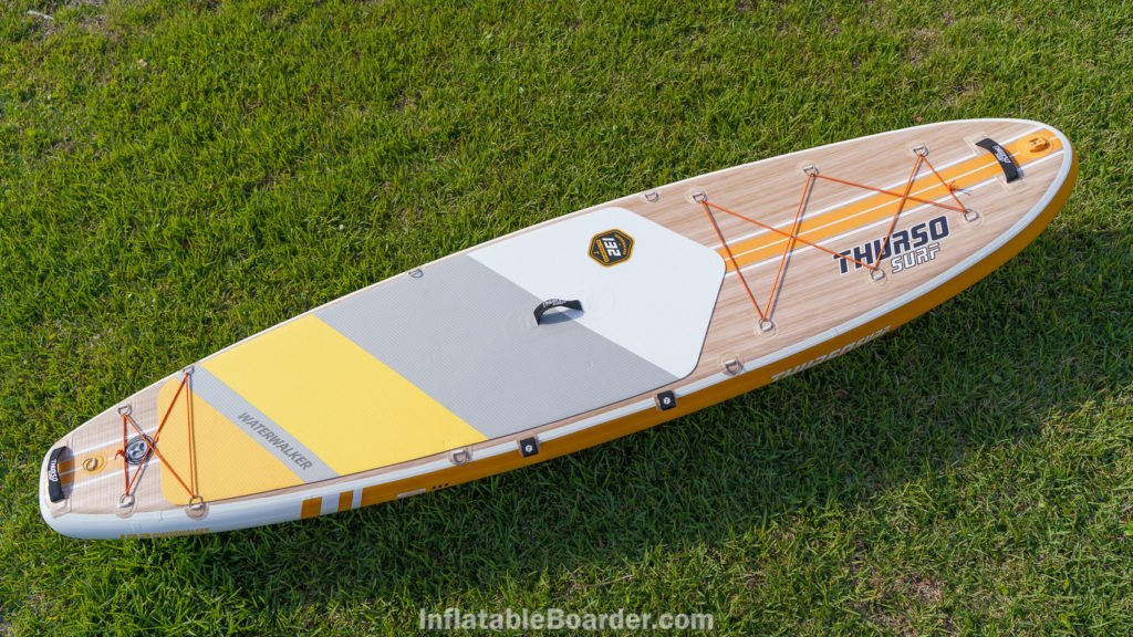 Top view of the Waterwalker 132, featuring two cargo areas, 3 padded handles, 1 action mount, a side paddle holder, and 4 d-rings at the middle of the board.