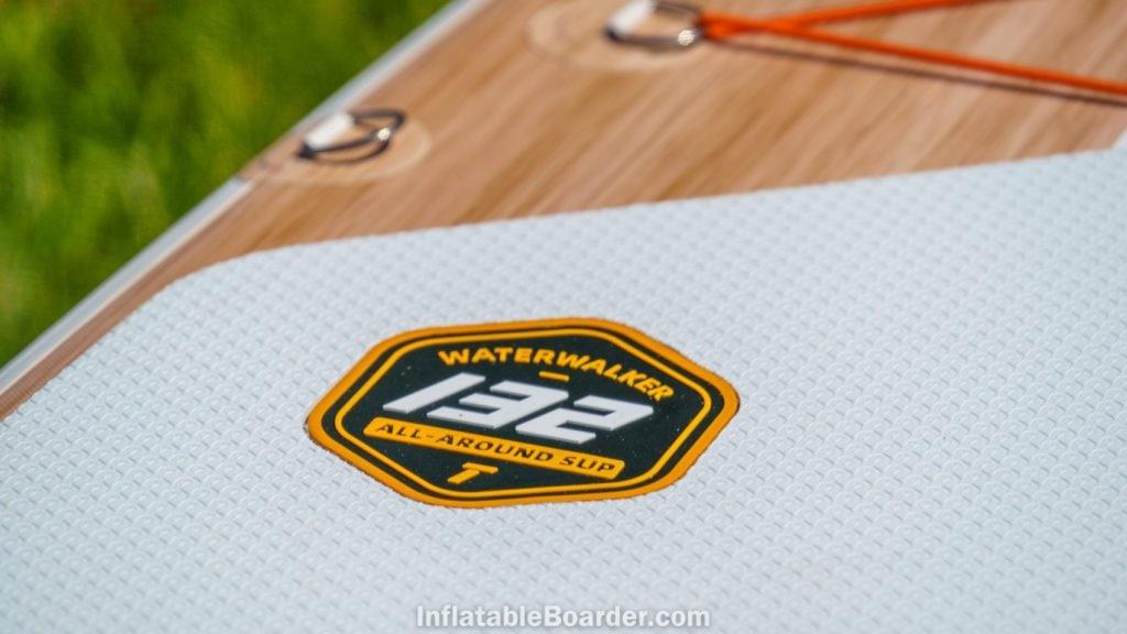 The tangerine orange badge reads Waterwalker 132 All-Around SUP.