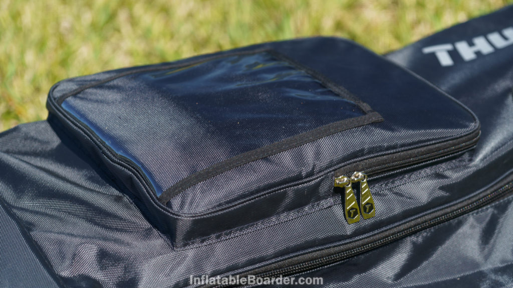 The front pocket of the bag has sturdy zipper pulls and a clear plastic windowed pocket.