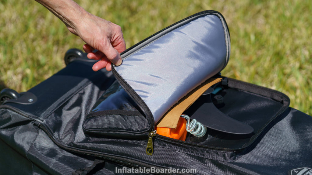 The front pocket is padded and just large enough to carry the fins, leash, and repair kit.