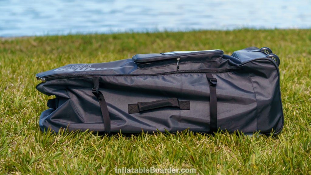 The side of the bag has compression straps and a padded handle.