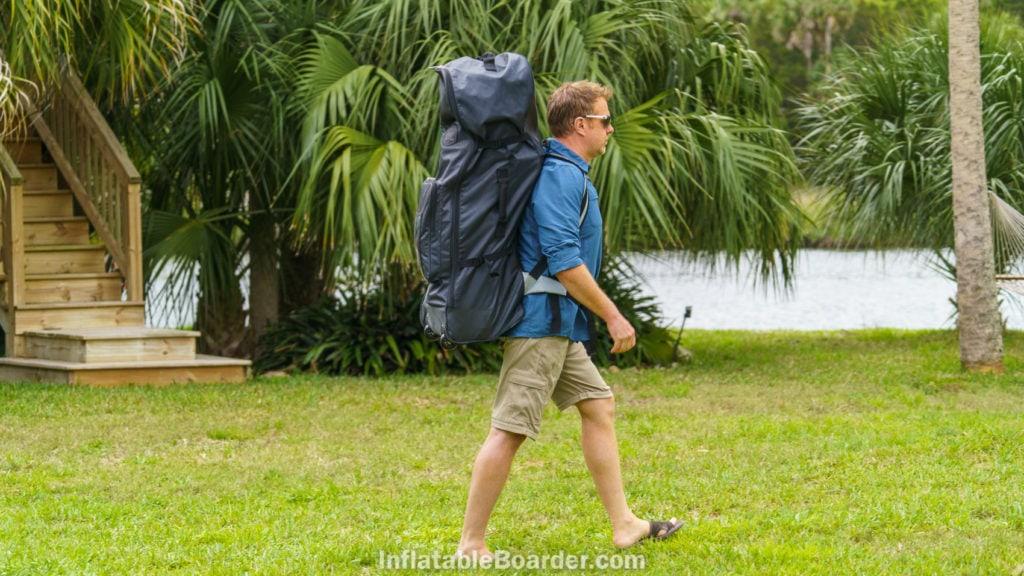 Carrying the Waterwalker backpack towards the water.