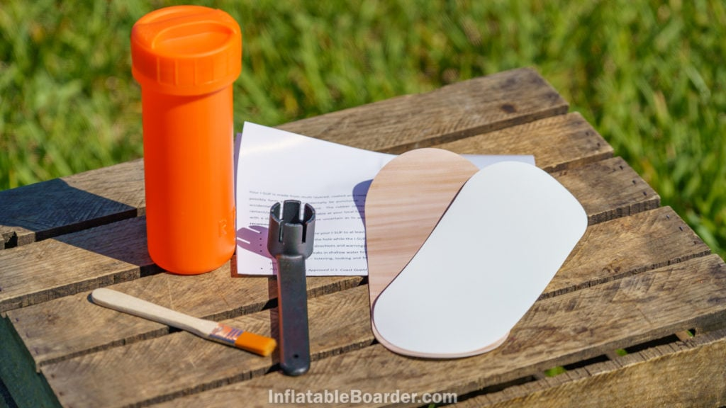 The repair kit includes instructions, a valve wrench, glue brush, and patches in white and wood texture.