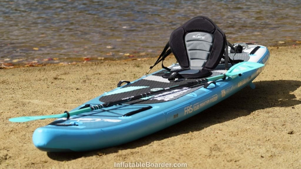 Cruise Carbon laying on a beach with kayak seat attachment.