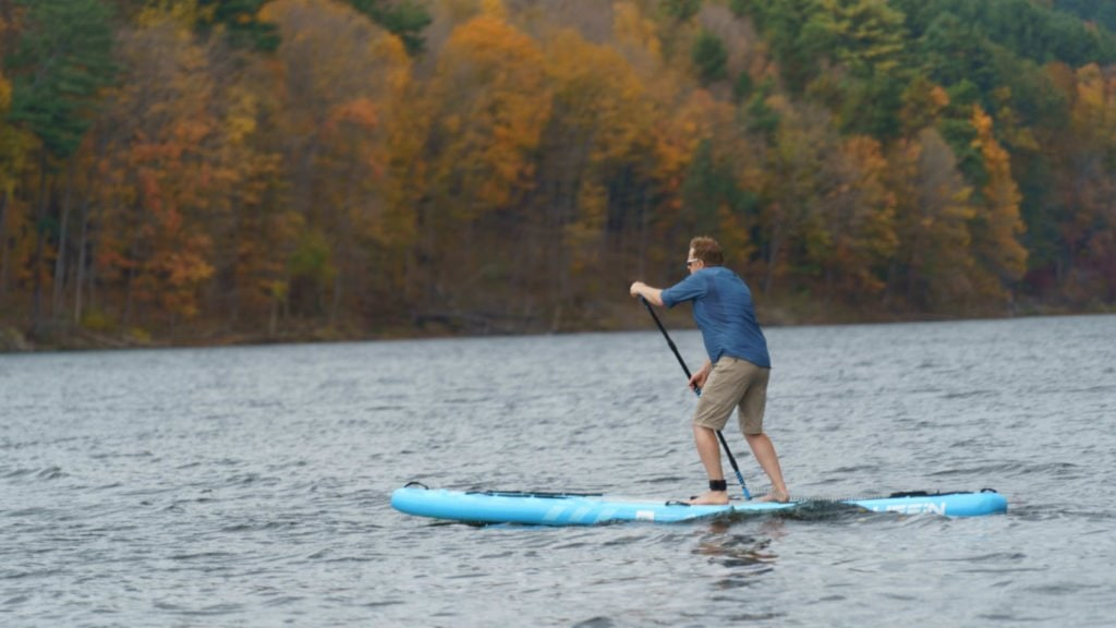 Rear view of paddling the Sprint on a lake.