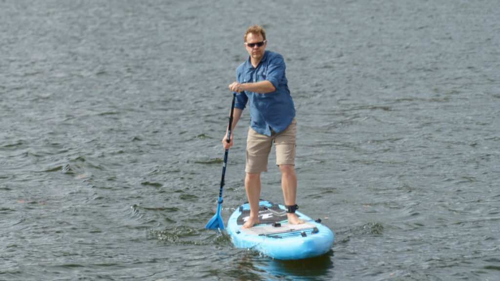 Paddling the board straight ahead to demonstrate tracking performance.