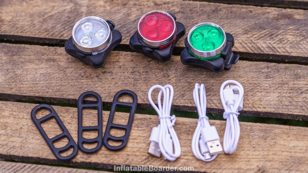NIXY SUP navigation lights include 3 red, green, and white LED lights, 3 mounting straps, and 3 USB cables.