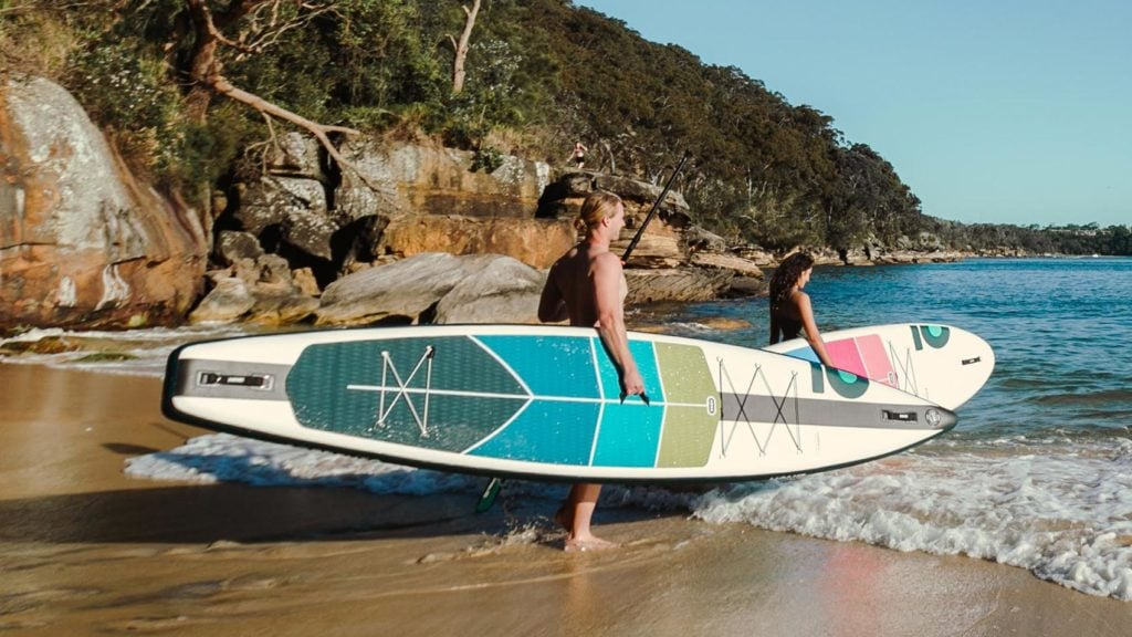 Carrying the HONU Sorrento paddle board to ocean