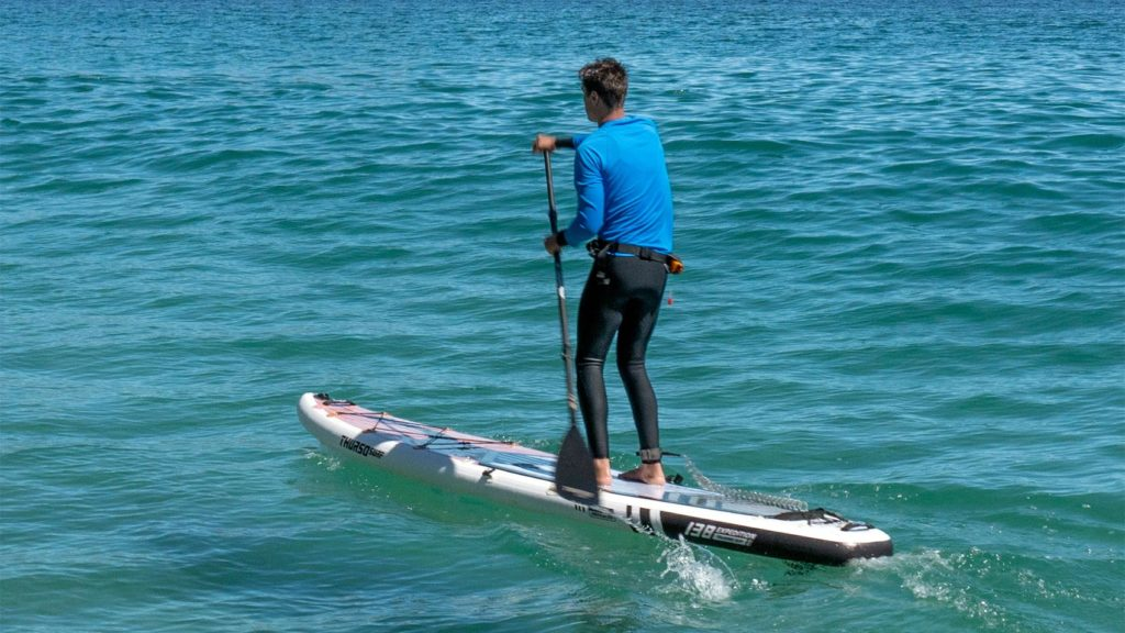 Paddling the Expedition on a choppy ocean.